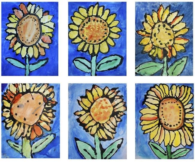 Sunflowers made by outlining them with black glue and filling in with water colors (First Grade Art)