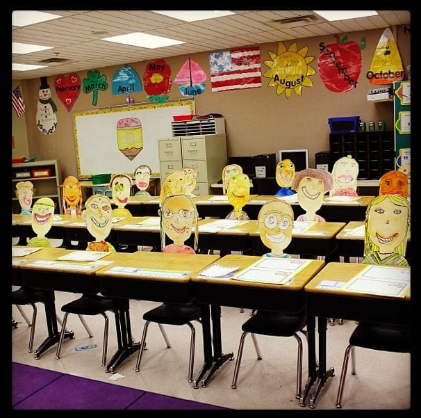 Cut out student faces in desks