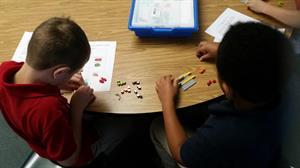 boys playing with LEGO bricks