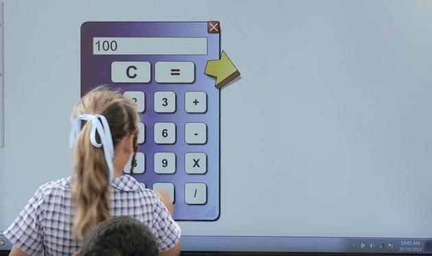 Teacher using calculator on screen