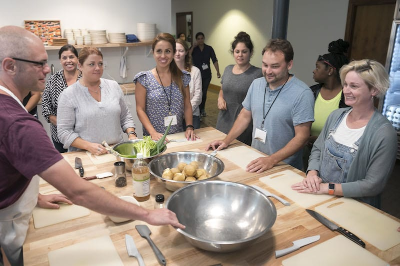 Adults in a cooking class - Free Teacher Trip