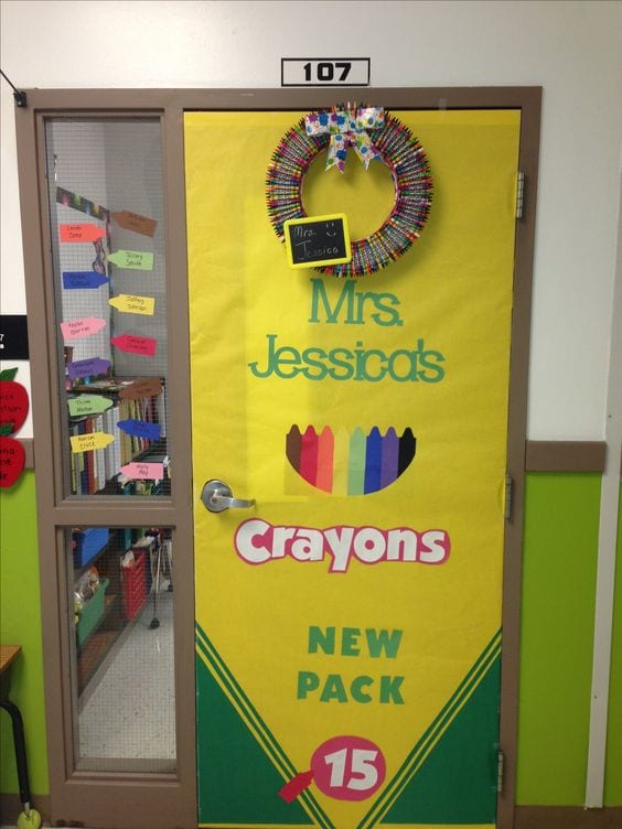 """Door decoration of a life-size box of crayons, saying """"Mrs. Jessica's crayons"""""""