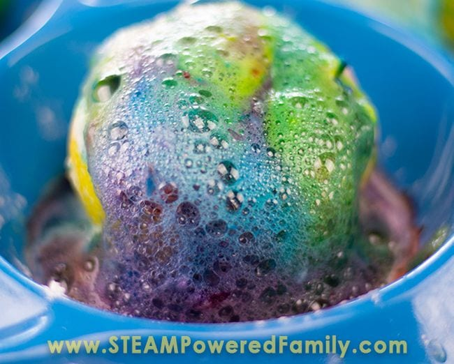 Cut lemon in a blue bowl covered in colorful fizzy foam (Fourth Grade Science)