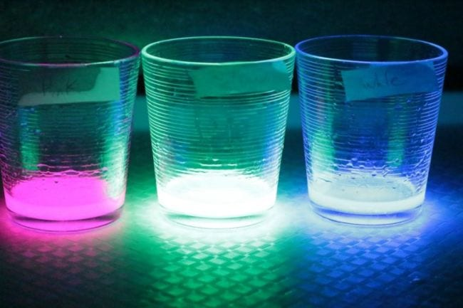 Three clear glasses filled glowing liquids (Fifth Grade Science)