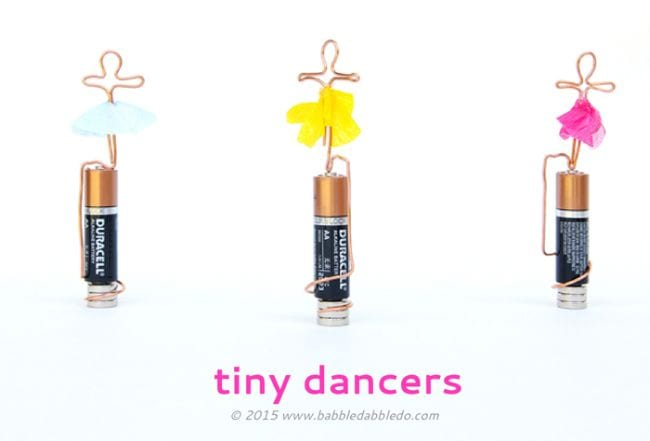 AA batteries with tiny wire figures twisted around them, with tutus added to look like ballet dancers (Sixth Grade Science)