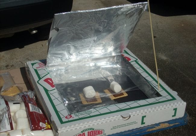 Pizza boxed turned into a solar oven, propped open with graham crackers, chocolate, and marshmallows inside (Seventh Grade Science)