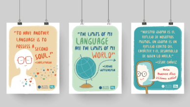 Three Free World Language Posters hanging from paperclips