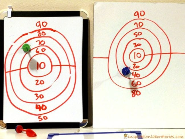 Two hand-drawn dartboards with darts on the 70 ring and 40 ring (Active Math Games)