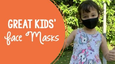 "A young girl wearing a black face mask. There is orange text on the picture that reads ""Great kids face masks."""