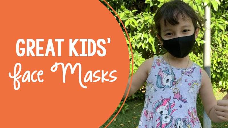 A young girl wearing a black face mask. There is orange text on the picture that reads Great kids face masks.