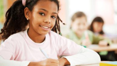 Black girl writing at desk
