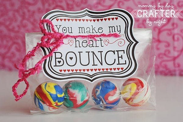 """cellophane bag filled with four colorful bouncy balls and a card that says, """"You make my heart bounce."""""""