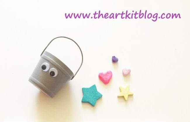 Small wood bucket with google eyes and wooden embellishments (Bucket Filler Activities)