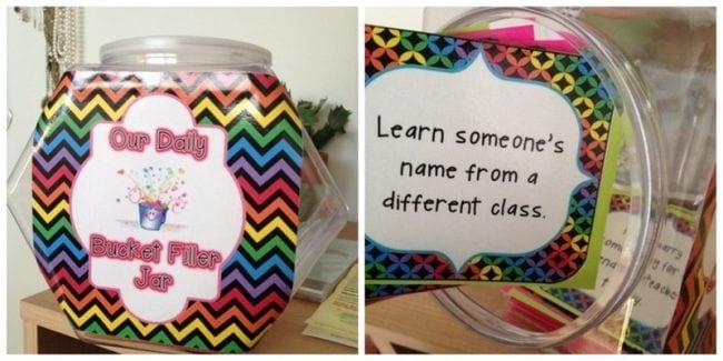 Large plastic jar labeled Our Daily Bucket Filler Jar