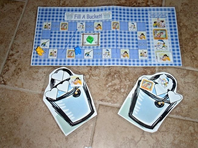 Bucket filler board game with large paper buckets