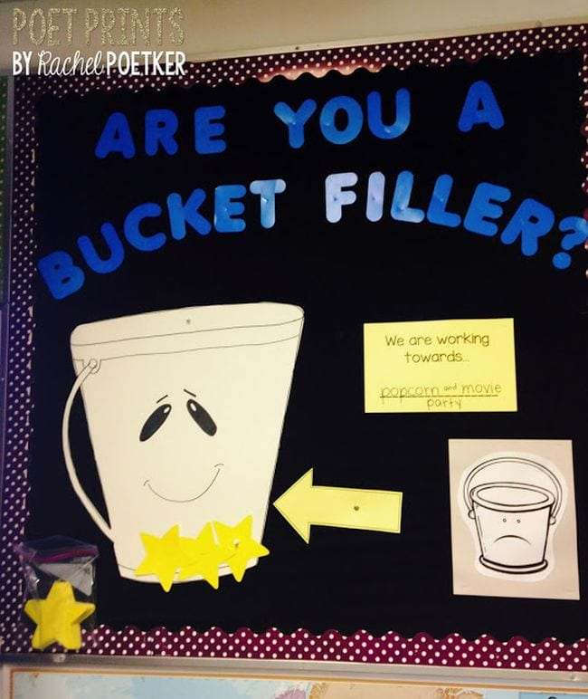 Bulletin board with paper buckets; text reads Are You A Bucket Filler?