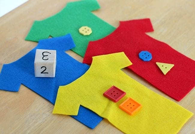 Buttons on felt with dice.