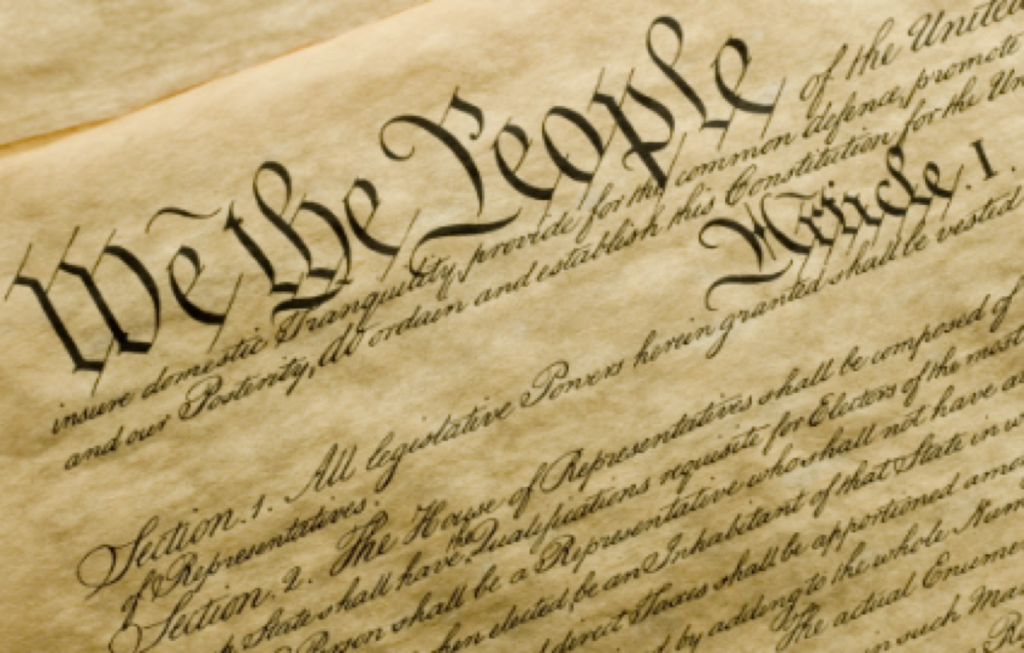 "Paper saying ""we the people..."""