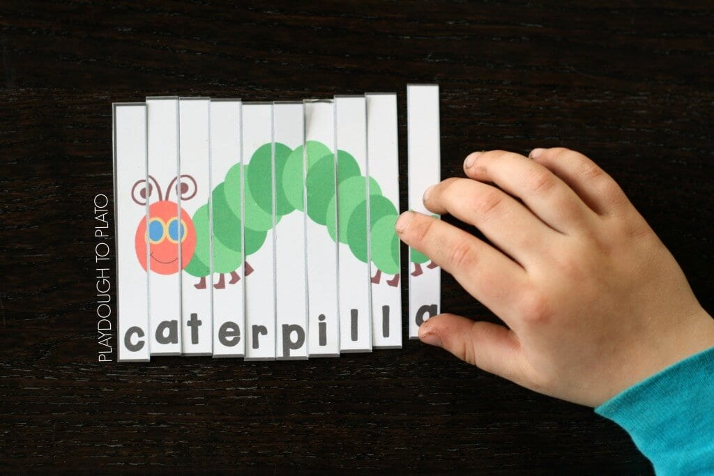 A word puzzle for students made from a drawing of a caterpillar cut into vertical strips. Each strip has a different letter of the word 'caterpillar' printed on it.