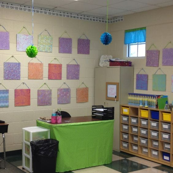 dresser knobs with hanging cork board squares on classroom wall.