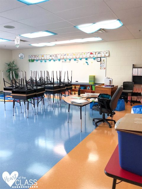 Classroom before photo with stacked desks
