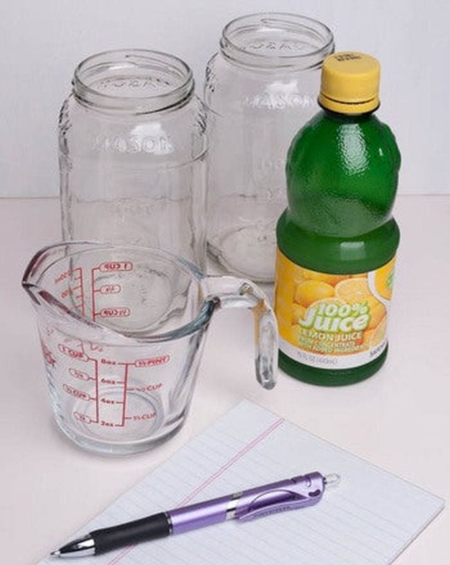Glass measuring cup, glass jars, and bottle of lemon juice (Climate Change Activities)