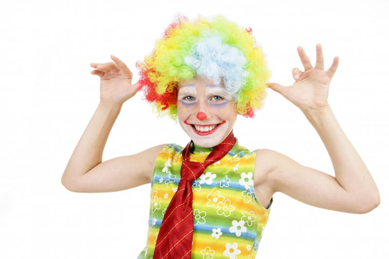 child dressed as clown