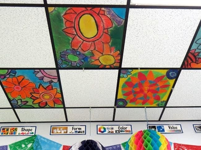 Ceiling tiles decorated with colorful flowers in oranges and reds
