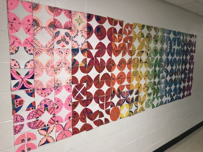 Paper quilt squares made of quartered circles in different colors