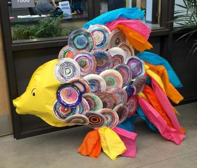 Large paper fish with individually decorated paper plates for the scales and tissue paper tail and fins
