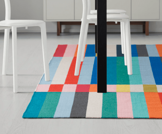 Colorful rug with square and rectangle colored tiles