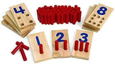 Wooden boards with different holes to represent numbers.
