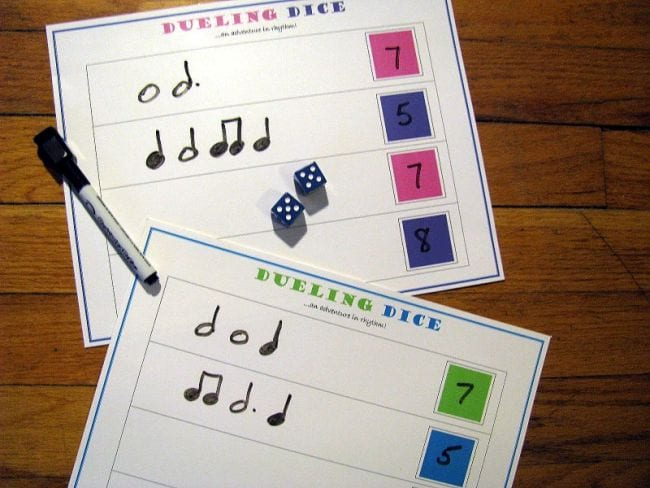 Dueling Dice worksheets with music note rhythmic notation, dice, and marker