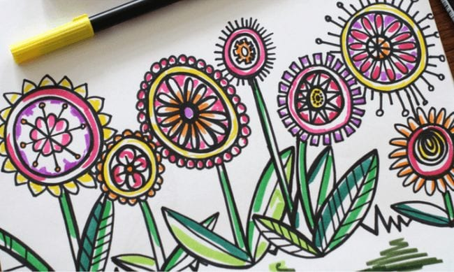 Abstract flowers outlined in black and colored with markers - Directed Drawing