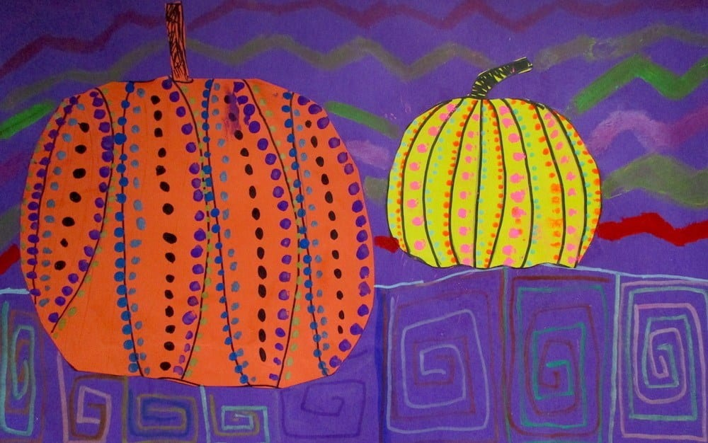 Orange and yellow construction paper pumpkins with dotted patterns on purple background