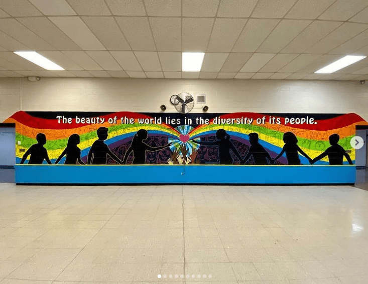 School mural with rainbow and diversity quote