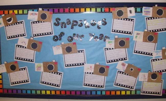 Bulletin board of Snapshots of Our Year with student writing assignments (End of the Year Assignments)