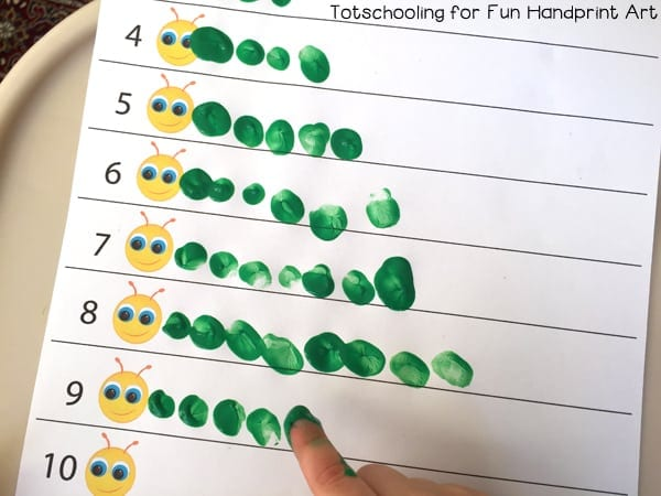A worksheet showing caterpillars made from fingertips dipped in paint
