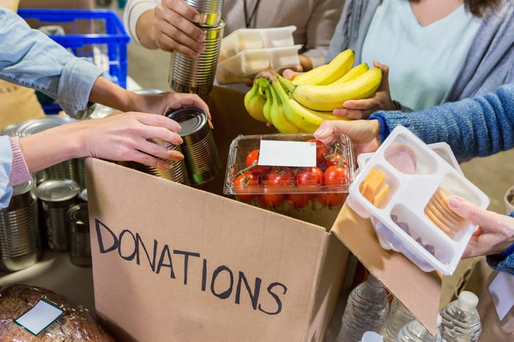 Donations box full of fruit -- Volunteer Projects Help Teens