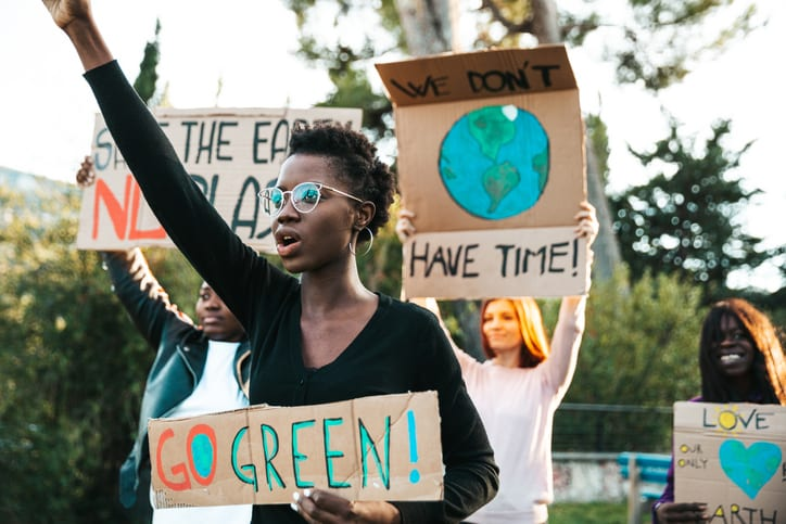 Students holding climate change signs