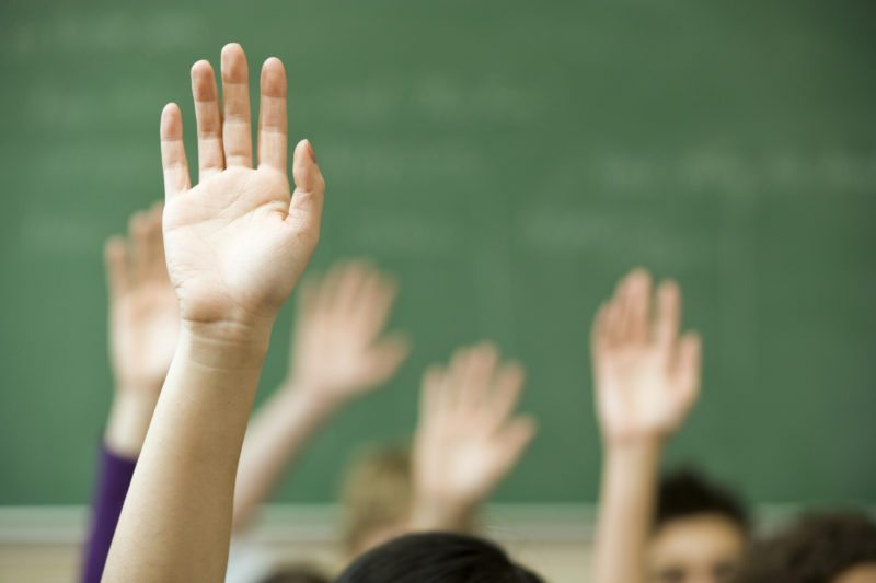 Moving Beyond: Classroom Discussions hand raised