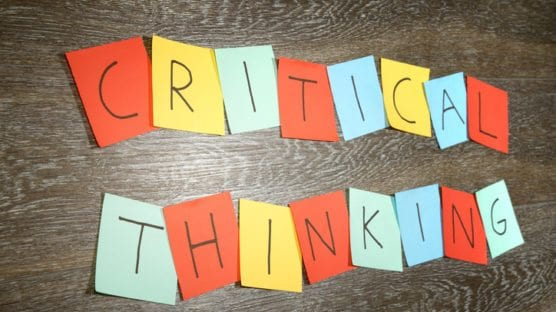 """Critical thinking"" written on sticky notes"