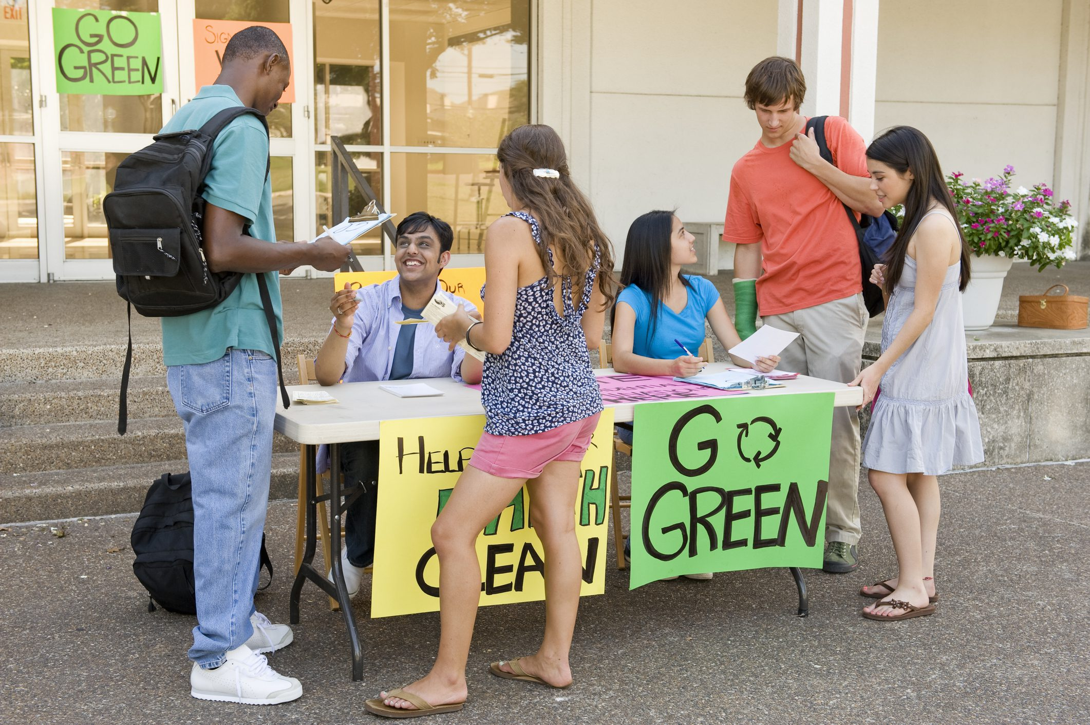 Kids with posters to Go Green for zero waste schools