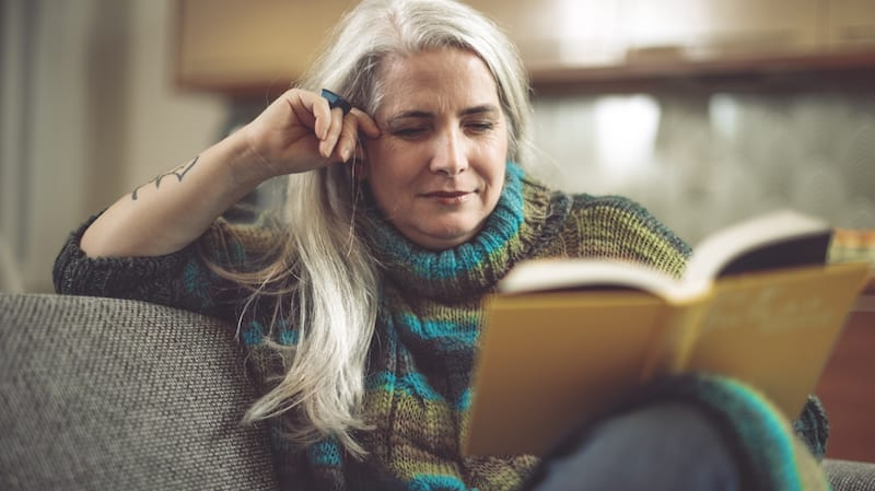 Mature woman at home reading
