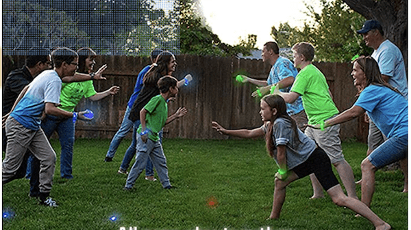 A family playing glow in the dark capture the flag outside