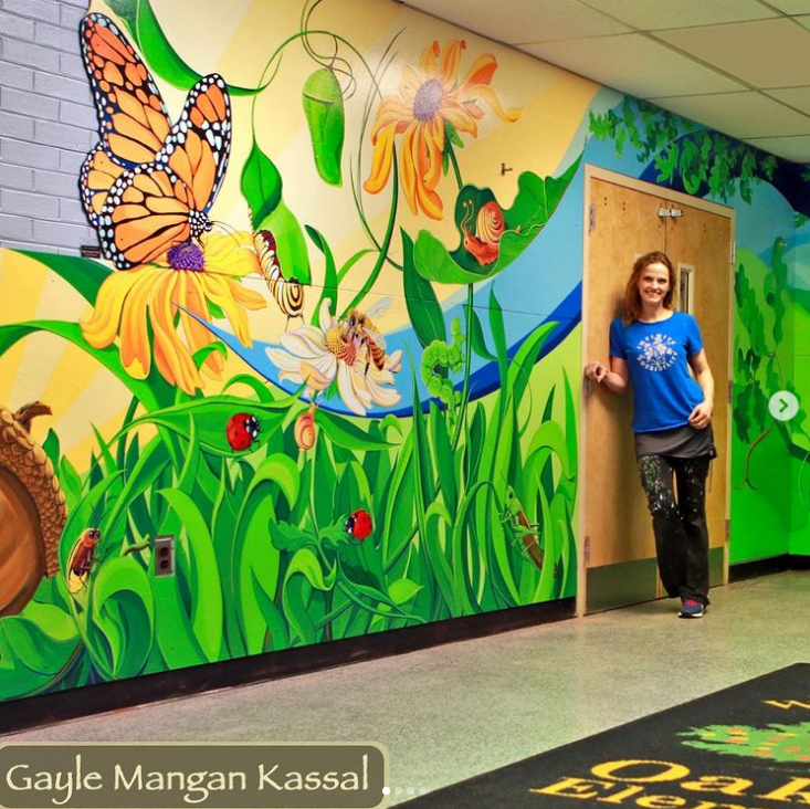 School mural featuring nature and butterflies
