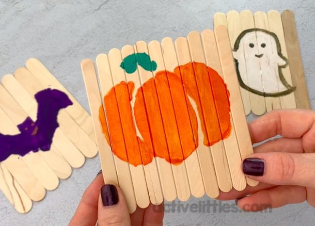 Halloween themed puzzles made on wood craft sticks laid flat side by side