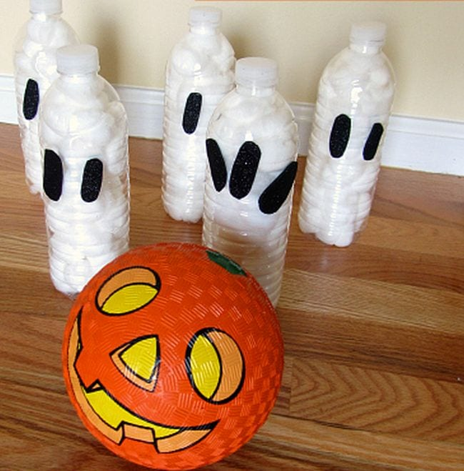 Plastic bottles filled with cotton swabs and painted to look like ghosts with an orange jack-o-lantern rubber ball (Halloween Activities)