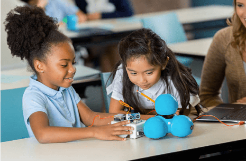 Girls working with Dash & Dot