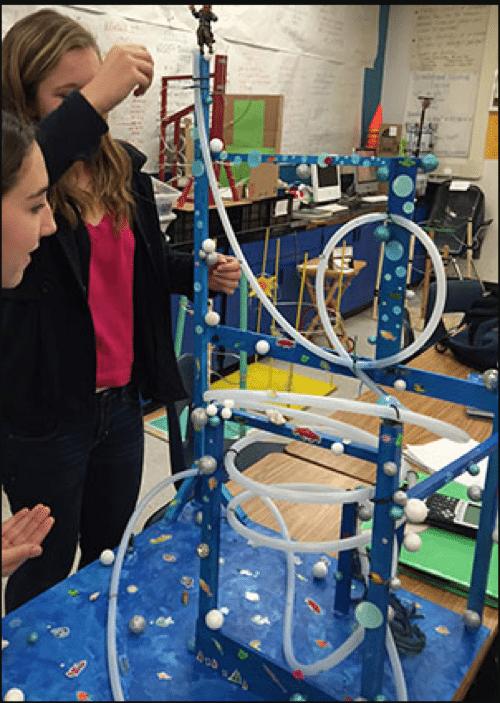 Kids construct roller coaster